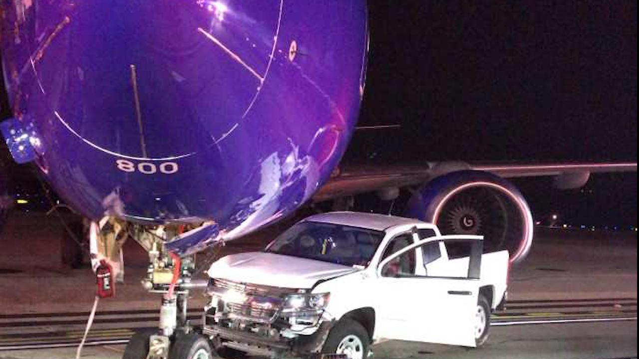A pickup truck collided with a Southwest plane on anBaltimore-area airport tarmac. An internal investigation is underway.