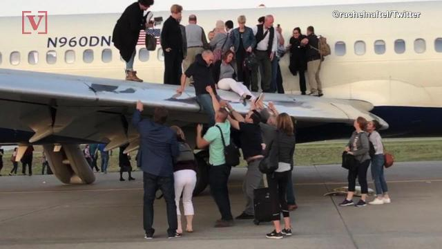 Another terrifying moment for airline passengers when a Delta flight in Denver reported smoke in its cabin, forcing an evacuation. Nathan Rousseau Smith has the images.