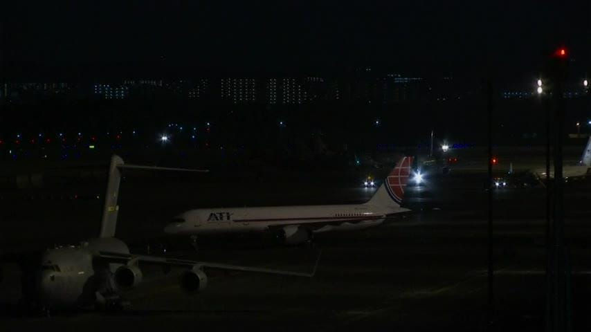 Americans freed from NKorea lands in Japan
