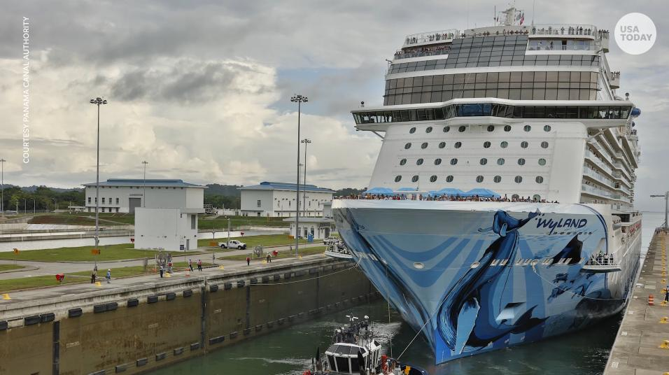 Exclusive drone video shows the massive, new Norwegian Bliss making history as the largest cruise ship to transit the Panama Canal. The canal was expanded to accommodate mega-ships in 2016.