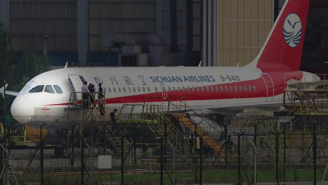 A Sichuan Airlines flight was forced to make an emergency landing after the cockpit windshield  blew out and sucked the co-pilot halfway out.