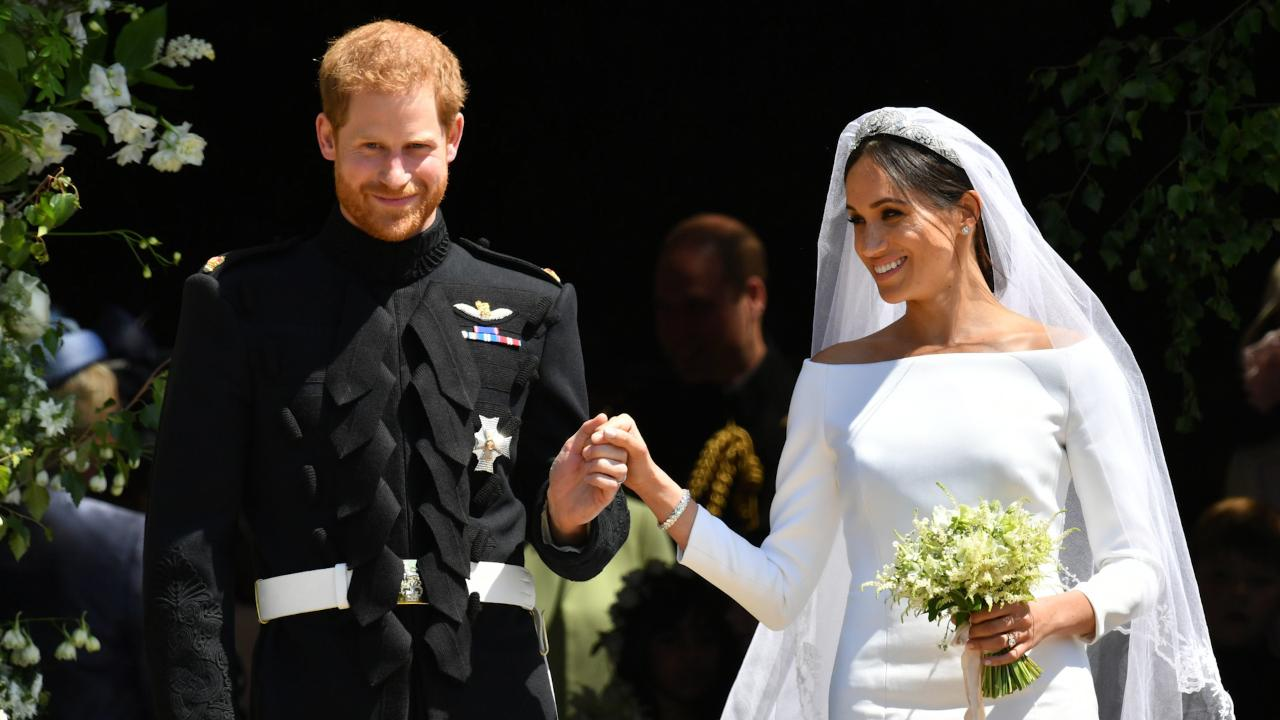 Prince Harry and his new bride Meghan Markle leave the church together as newylweds!