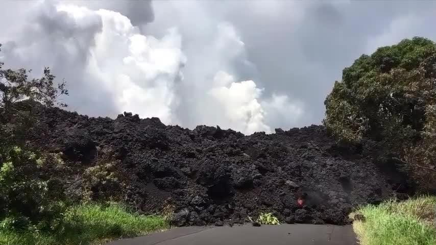 Officials on Hawaii's Big Island say lava from an erupting volcano has crossed a highway and flowed into the ocean. The highway has shut down in some spots, and residents in the area have been evacuated. (May 20)
