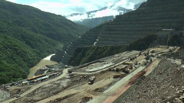 Colombia evacuates 25,000 near hydropower construction site.