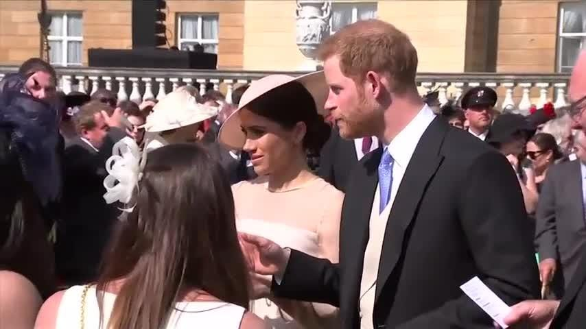 Prince Harry and Meghan, the Duchess of Sussex, on Tuesday attended their first royal event as newlyweds, a Buckingham Palace garden party honoring Harry's father, Prince Charles, for his many years of charitable work. (May 22)