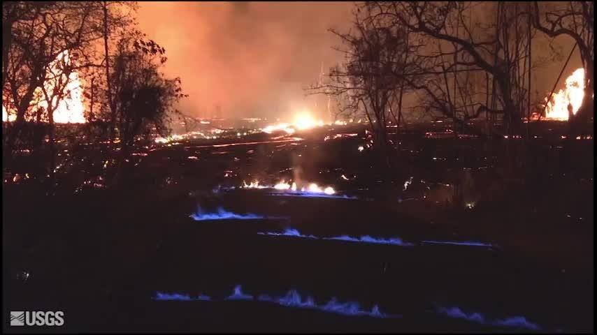 blue flames emitting from hawaii eruption