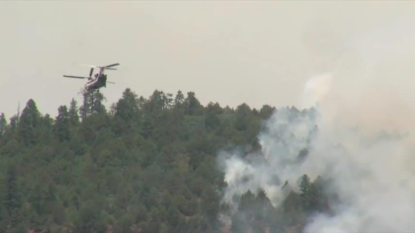 Colorado wildfires close national forest as acres burn throughout West