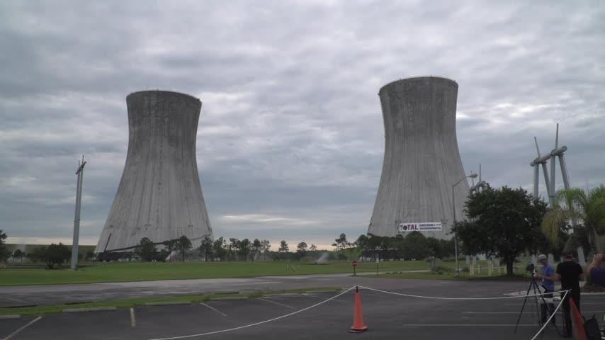 Two 462-foot-tall cooling towers at the St. Johns River Power Park were simultaneously imploded in Jacksonville, Fla., on Saturday. The coal-fired electric plant was closed in January. (June 16)