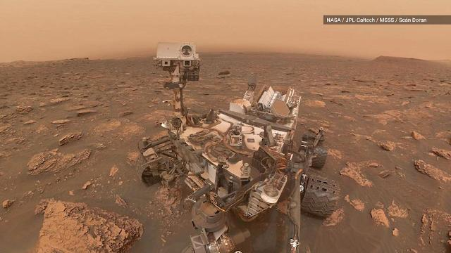 NASA's Curiosity Rover is living its best life through a massive dust storm on Mars, while Opportunity has been forced to hunker down.