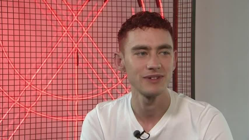 "Years and Years singer Olly Alexander says he feels like an ""invincible alien warrior"" on stage. (July 16)"