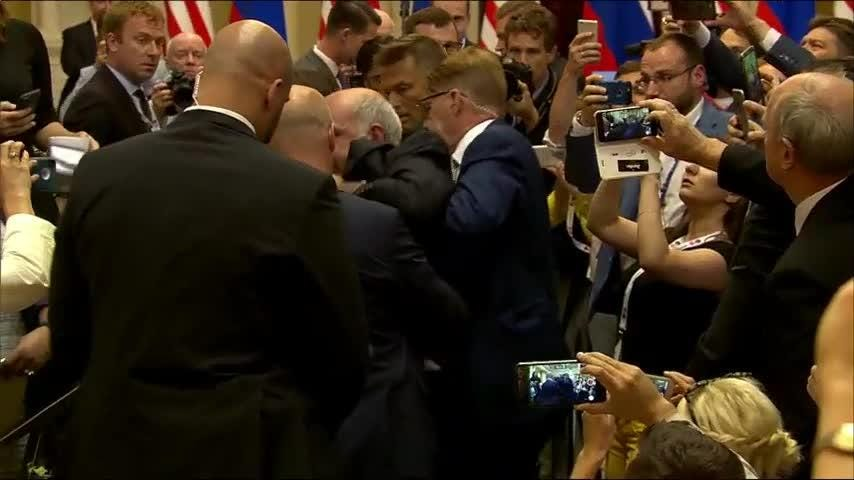 An apparent protester has been escorted out of a joint press conference between President Donald Trump and Russian President Vladimir Putin. The individual, seated with the American press corps, was holding a sign about nuclear weapons. (July 16)
