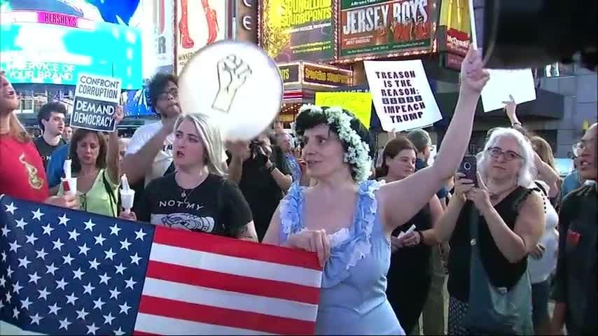"Demonstrators gathered in New York City's Times Square on Wednesday evening to denounce President Trump. Protesters held signs accusing the President of treason and chanting ""we the people say you are fired."" (July 19)"