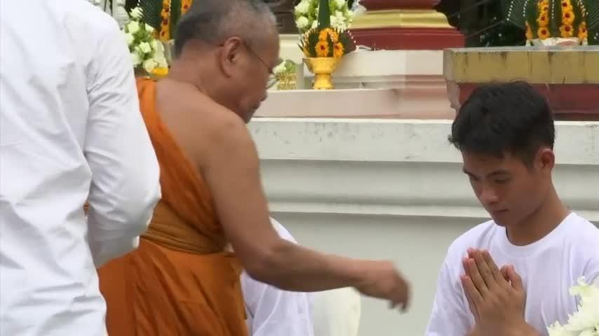 Thai soccer boys becoming novice Buddhist monks