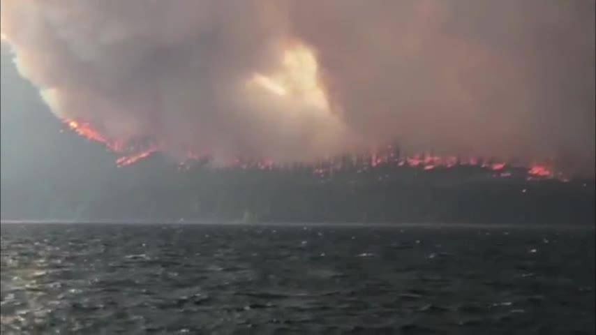 Cell phone video captured a wildfire as it raged through Montana's Glacier National Park on Monday. Hundreds of visitors had to be evacuated. Several homes and structures were also destroyed. (Aug. 14)