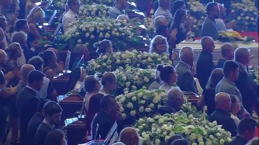 Mourners at a state funeral on Saturday for victims of the Genoa bridge collapse applauded as the names of the deceased were read out. (Aug. 18)