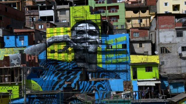 Brazilian footballer Jesus gets mural in hometown favela