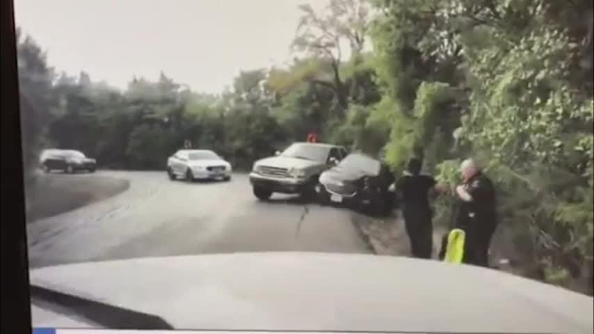 A dashboard camera shows a close call, as a truck skids out of control and narrowly misses a Texas police officer and the driver he was helping along a country road. (Sept. 21)
