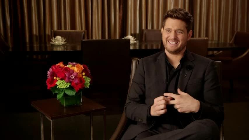 """Michael Buble says rumors of his retirement from music are false. The singer is releasing a new album titled """"Love"""" next month. (Oct. 17)"""