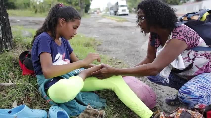 Barely able to feed her daughter and struggling to earn a living, Sandra Cadiz made the desperate decision to leave Venezuela by foot. For nine days AP journalists followed them as they tried to cross three borders to join family in Peru. (Oct. 18)
