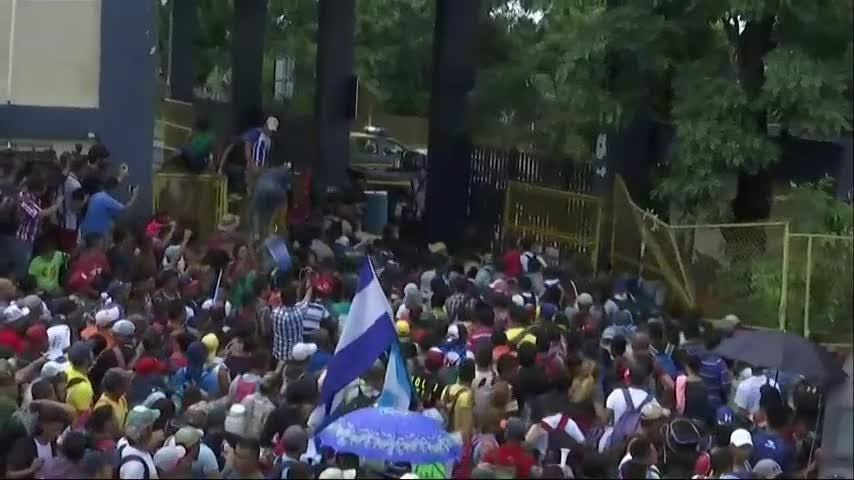 On Friday, the migrant caravan of at least 3,000 broke down gates at the Guatemalan border with Mexico and streamed toward a bridge to Mexico. (Oct. 19)