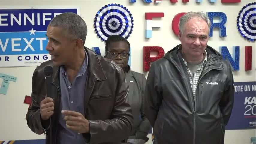 Obama cheers Va. campaign volunteers with donuts