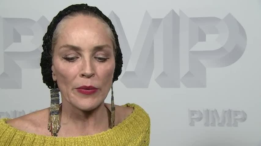 Sharon Stone directs red carpet traffic