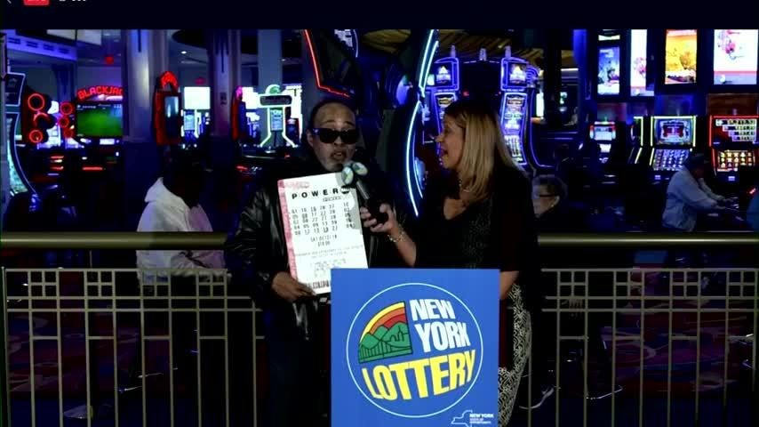 Robert Bailey was introduced Wednesday by New York lottery officials as the winner of last months record-breaking Powerball jackpot. Bailey shares his winnings of nearly $700 million, with a woman in Iowa who also picked the winning combo. (Nov. 14)
