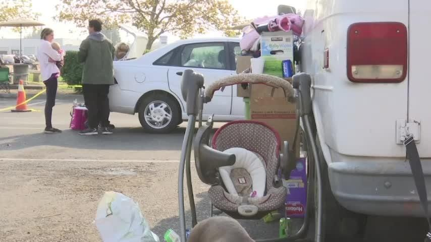 Wildfire victims living in parking lot seek help