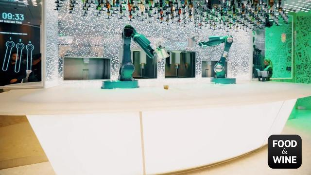 Inside the Bionic Bar on Royal Caribbean's Symphony of the Seas, where robot bartenders mix custom drinks for guests.