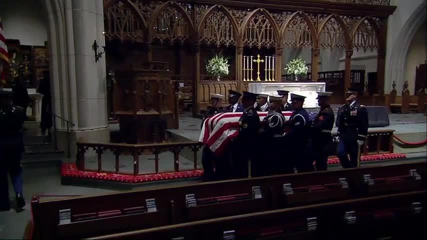 As a military band played, pallbearers carried the flag-draped casket of former President George H.W. Bush into Houston's St. Martin's Episcopal Church, where the Bush family regularly worshipped. (Dec. 5)