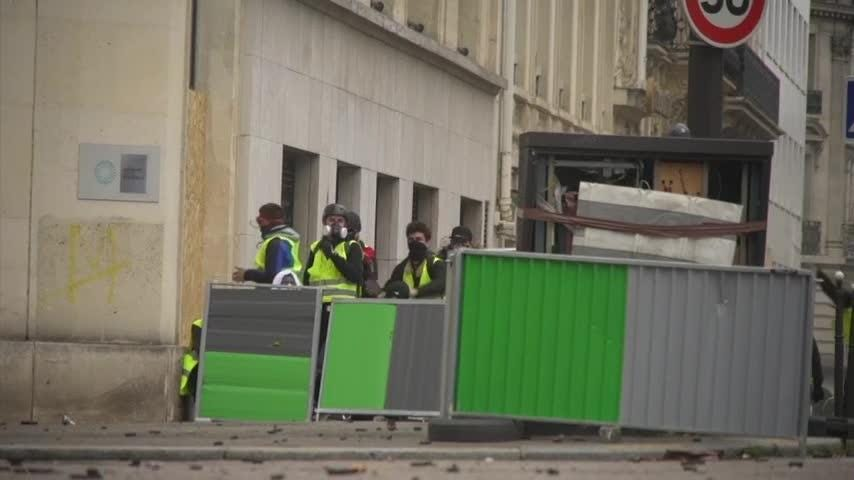 Protesters angry at their President and France's high taxes returned to the streets of Paris on Saturday, amid exceptional security measures aimed at preventing a repeat of last week's rioting. (Dec. 8)