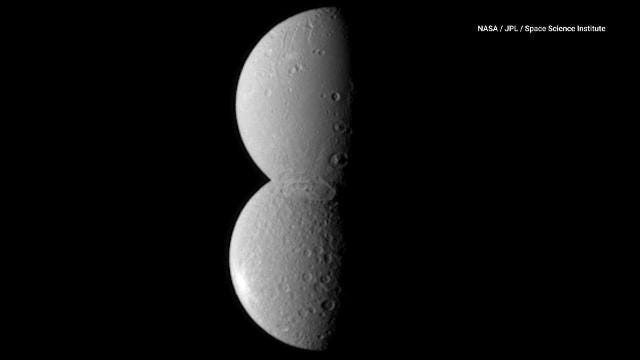 Saturn's moons Rhea and Dione are getting us into the holiday spirit thanks to a unique Cassini probe image.