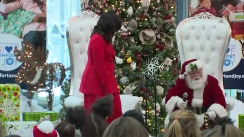 """Former U.S. first lady Michelle Obama visited Children's Hospital Colorado in suburban Denver on Thursday. Mrs. Obama read """"The Night Before Christmas,"""" answered questions from children and encouraged Santa Claus to get up and dance. (Dec. 14)"""