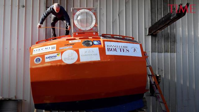 72-year-old French explorer completes journey across the Atlantic inside big, orange barrel