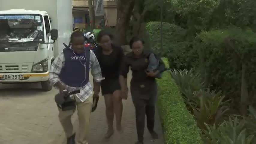 Extremists attacked a luxury hotel in Kenya's capital Tuesday, sending people fleeing in panic as explosions and heavy gunfire reverberated through the complex and black smoke rose over the scene. A witness reported seeing at least two bodies. (Jan. 15)