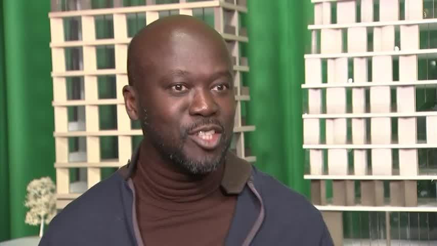 British architect Sir David Adjaye splashed out on an expensive suit when picking up his first-ever award. (Jan. 17)