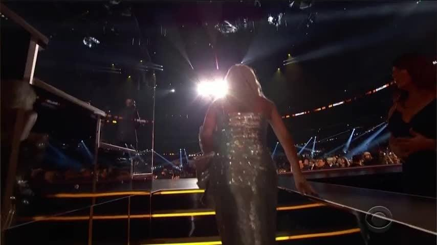 The Grammy Awards kicked off Sunday with a group of powerful women, including Michelle Obama and Lady Gaga, describing the role of music in their lives. (Feb. 10)