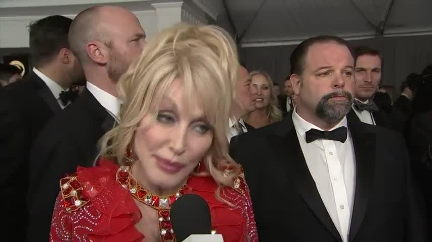 Music icon Dolly Parton reveals she still loves being involved with music on the red carpet of the Grammys in L.A. (Feb. 11)