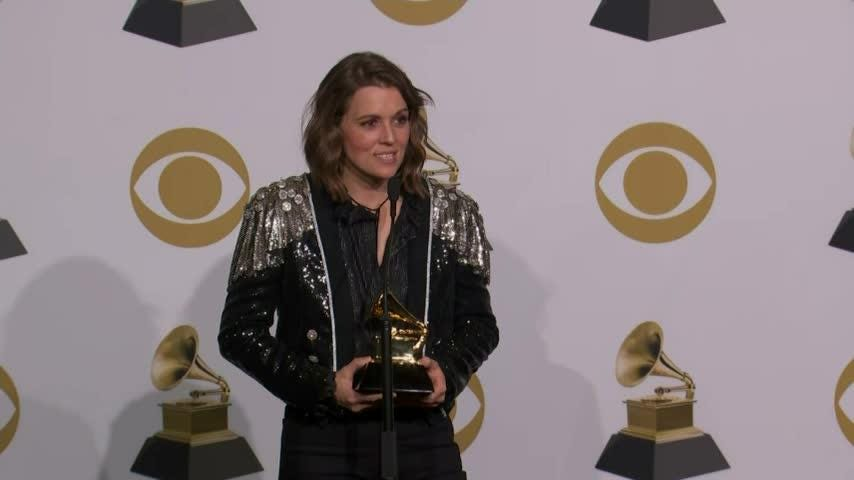 Brandi Carlile reveals the peaceful look on Janelle Monae's face helped settle her nerves at the Grammys. (Feb. 11)