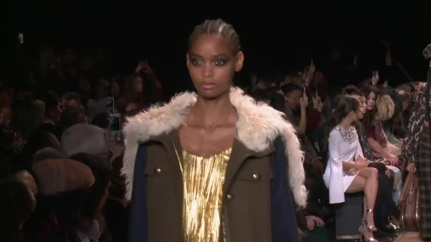 Michael Kors throws a '70s fashion show - complete with Barry Manilow performance - on the closing day of New York Fashion Week. He says the collection was designed as a boost of joy and optimism. (Feb. 14)