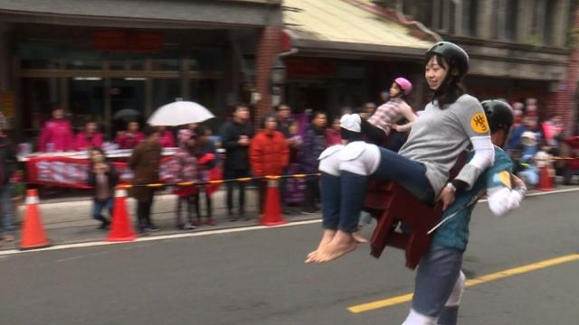 More than two dozen couples take part in a piggyback contest in Taiwan as part of the Lunar New Year celebration in Taiwan. Video provided by AFP