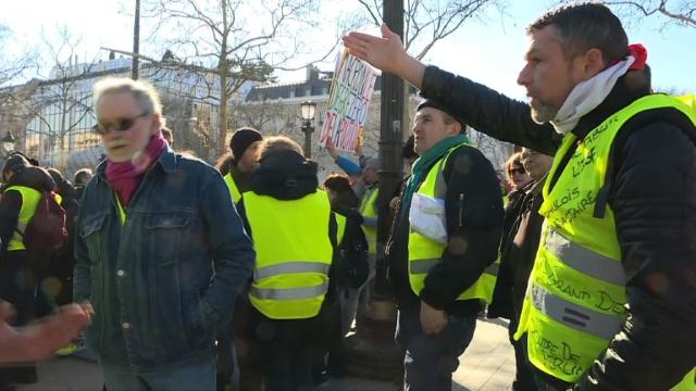 """""""We don't want to survive, we want to live,"""" says a """"yellow vest"""" demonstrator protesting near the Arc de Triomphe in Paris. Nearly 300 """"yellow vest"""" protesters were gathered in the late morning in calm on the Champs-Elysées for a new day of mobilization, three months to the day after the beginning of this protest movement. Video provided by AFP"""