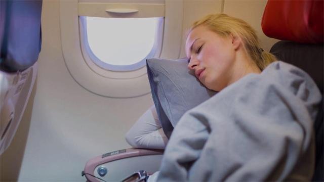 Getting good sleep on a plane can be difficult — but not impossible.