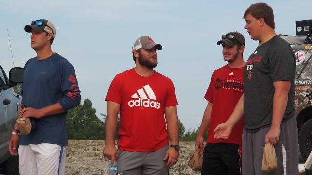 Louisville football players go fishing with military veterans
