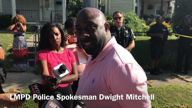Dwight Mitchell speaks at the scene of Sunday's shooting