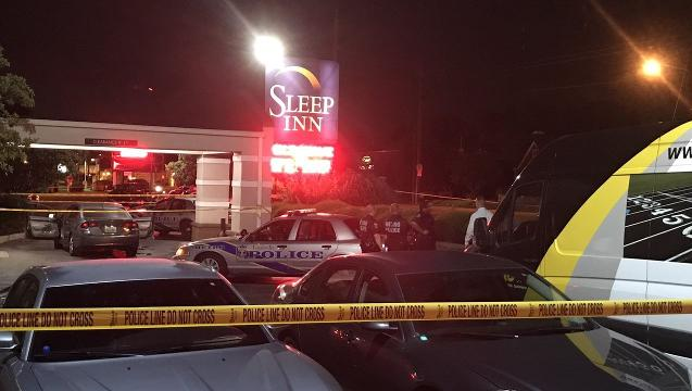 Two men were shot early Thursday morning when police found them at the Preston Highway Sleep Inn. One man died, said LMPD spokesman Dwight Mitchell.