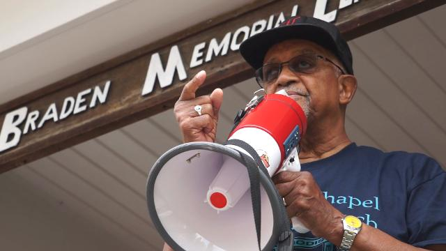 Hundreds came together Sunday at a rally hosted by Black Lives Matter Louisville to show solidarity with the victims of Saturday's violence in Charlottesville. Aug. 13, 2017