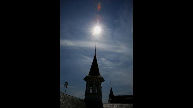 Time lapse: Watch the eclipse over Churchill Downs Twin Spires