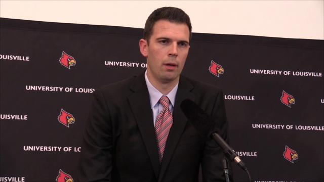 Interim Louisville coach David Padgett talks to the press