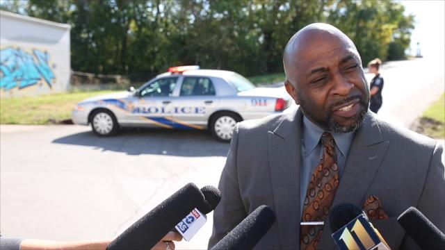 LMPD spokesperson, Dwight Mitchell, speaks to media about the shots fired near Ziegler Avenue on Thursday. Two suspects were apprehended by LMPD, one was carrying a rifle.
